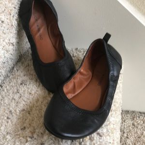 Black leather ballet flats size 8.5